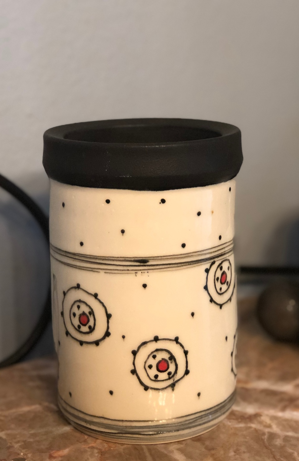Pottery wine cooler with red dot and organic circles in black